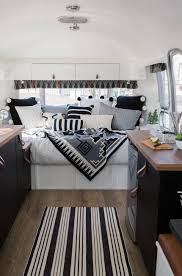 Eclectic home office alison Alison Kandler Alison Mcquain Photography Alison Kandler Interior Design Husband Wifes Vintage Airstream Is Renovated Home And Office On