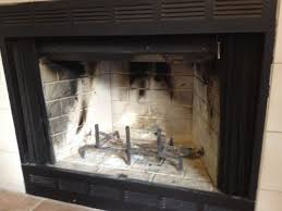 photos that it was a wood burning gas zero clearance fireplace i ve looked and can t find any info on these thoughts can i convert to gas logs