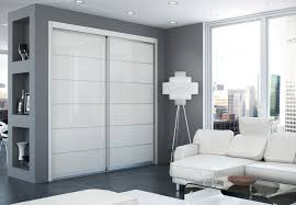 sliding menards closet doors with floor lamp and white sofa for home decoration ideas