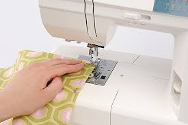 Image result for sewing machine use