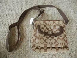 NWT Coach Park Signature Swingpack Crossbody Bag 49148 SKHMA Khaki Mahogany  1 of 6 See More