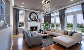 luxury interior design ideas living room with fireplace under round wall mirror and elegant curtains on sliding glass door
