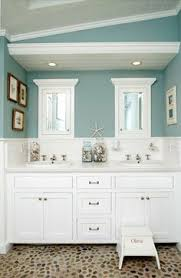 Awesome beach theme bathroom redo for Kids bathroom or guest bathroom. and  Love the wall color!