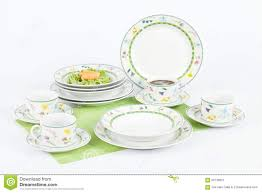 white modern dishes with figures flowers shapes stock photo