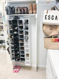 I looked at a bunch of different options, but ended up going with the  Container Store 12 Pair Shoe Organizer.