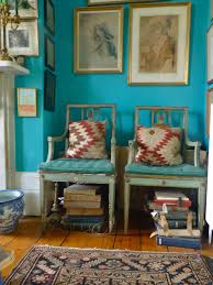 Bright Turquoise for the livingroom. Bohemian at its best! - Turquoise wall  - Old tribal rug - Vintage chairs with kilim rug pillows - Mismatched art -  Wide ...
