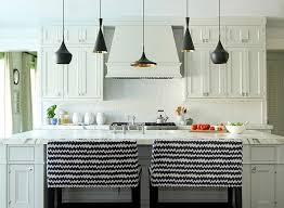 tom dixon beat light above a kitchen island hanging the lights at diffe