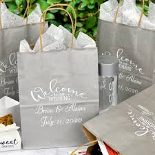 silver 8 x 10 kraft paper wedding wele bag personalized with arched wedding wele design and harvest gold kraft paper gift bags