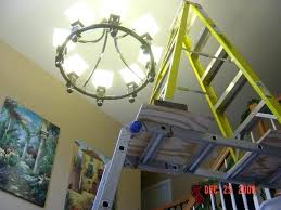 chandelier light bulb changer medium size of chandelier bulb changing pole replacing entry is 2 stories tall phone painting changer giraffe candelabra light