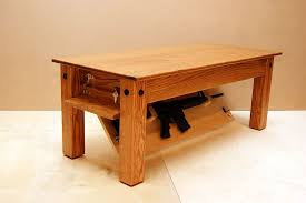 hide your weapons inside secret compartment of this oak coffee table