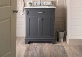 on trend planks of gray wood look vinyl flooring in a powder room or