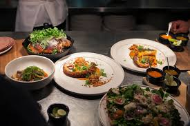 fine dining dishes. dishes are set in the kitchen for a brief moment before being taken out to diners at cosme new york city on thursday, march 3, 2016. fine dining