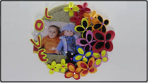 this photo frames idea uses an embroidery hoop as the frame and is decorated using handmade multicolored foam flowers this paper craft can be made easily