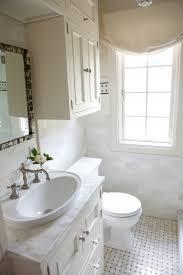 marble subway tiles backsplash ivory single bathroom vanity with oval vessel sink marble countertop and mother or pearl mirror