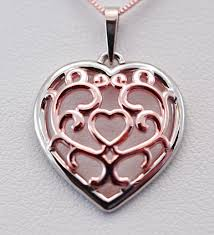 tangled hearts filigree bi color yellow and rose gold heart pendant