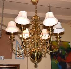 lot 1508 solid brass williamsburg style 6 light chandelier fitted with cloth shades measures 34 h x 36 w condition age appropriate wear