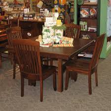 Square Artesa Oak Dining Table With  Inch Leaves Shown In - Amish oak dining room furniture