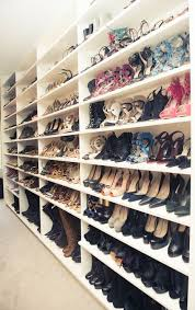 monique lhullier walk in closet with floor to ceiling shoe shelves