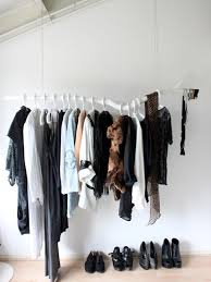 View in gallery White branch clothing rack