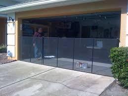 black pool fence installed across garage door