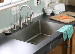 i love that i can just wipe crumbs right into the sink and there are no icky ridges where junk gets trapped i also love the clean sleek look of it