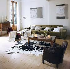 black and white cowhide rug living room decoration dark pastel green fabric modern cushion sofa
