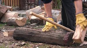 fireplace cement mix lumberman cutting firewood logs with axe man splitting wood to fit the fireplace