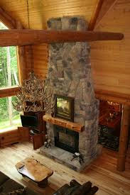 stone fireplace with custom carved mantel in a golden eagle log home