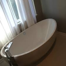 freestanding cost to install new bathtub average door a faucet