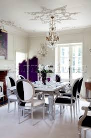 purple white dining room purple upholstered chair brown cushions and pendant lights round