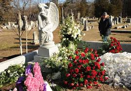 visitors view the gravesite of actress mary tyler moore following her private funeral at oak lawn