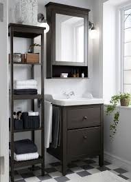 a small traditional bathroom with hemnes washstand shelf and mirror cabinet in brown
