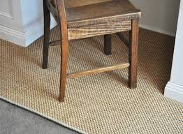 how to keep a rug in place on carpet