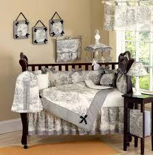 artistic dark brown wooden baby crib and grey baby bedding