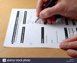 completing an application form to apply for proxy or postal vote completing an application form to apply for proxy or postal vote for an upcoming election
