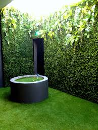 airwell with artificial green wall and artificial grass