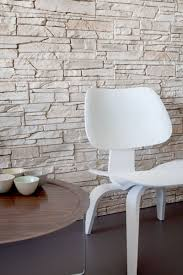 natural stone wall decor with white acrylic chair also round wood side table in elegant apartment
