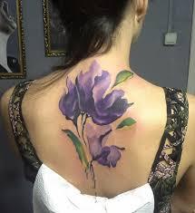 татуировка на спине у девушки цветы фото рисунки эскизы
