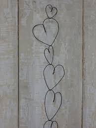 Wire Heart- so simple. maybe use all those wire coat hangers I have hanging  around. dont tell Joan (Crawford that is:) )