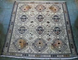 for is a beautiful and unique persian shahsavan soumak carpet this is a very unusual geometric design with twelve medallions with stylised figures of