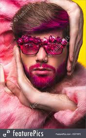 man in a pink fur coat and carnival glasses royalty free stock photo