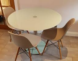 round glass table and dsw style dining chairs
