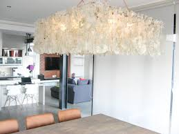 the chandeliers are handmade from glass that is collected by a team of trolley pushing recyclers a sight that has become so familiar in everyday south
