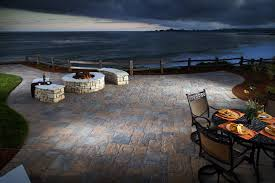 stamped concrete vs pavers for your