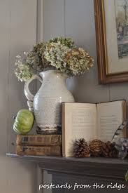 on our fall family room mantel i even opened an old book to an interesting page led how a witch was caught i thought it was fun for october