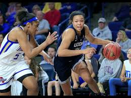 connecticut s napheesa collier drives to the basket as tulsa s jasmine butler defends during the first half of an ncaa college basketball game in tulsa