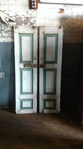 1820s wooden primitive shutter doors paneled green and white paint farmhouse barn wall decor