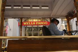 wells fargo cuts bonuses equity awards for top execs com
