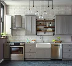 a backsplash of oversized white subway tile adds drama to stephanie and damian s once cramped