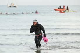 ross edgley celebrates finishing his great british swim in margate kent photo